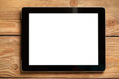 Tablet on Wood Royalty Free Stock Image