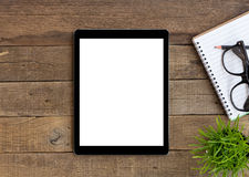 Tablet on wood table blank space for adjustment Royalty Free Stock Images