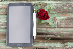 Tablet. On a wooden background Stock Images