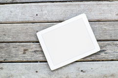 Tablet on wooden background. Stock Image