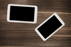 Tablet on wooden desk table. Royalty Free Stock Photography