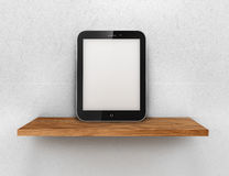 Tablet on the wooden floor Stock Photography