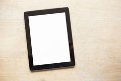 Tablet on wooden table Royalty Free Stock Images