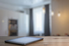 Tablet on wooden table Royalty Free Stock Photos