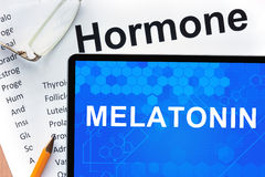Tablet  with word melatonin. Royalty Free Stock Photo