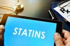 Tablet with word statins. Stock Images