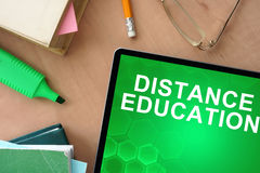 Tablet with words distance education Stock Photos