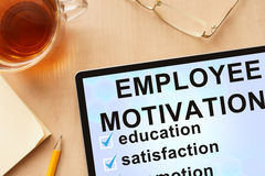 Tablet with words employee motivation. Business and management concept Stock Photos