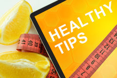 Tablet with words healthy tips Royalty Free Stock Images