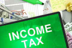 Tablet with words Income tax Stock Photos