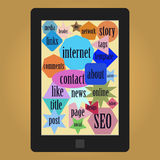Tablet with words or tags related to web Royalty Free Stock Photo
