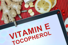 Tablet with words Tocopherol (vitamin E). Stock Image