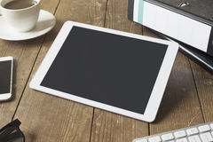 Tablet on workspace Royalty Free Stock Image
