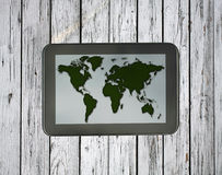 Tablet with world map Royalty Free Stock Images