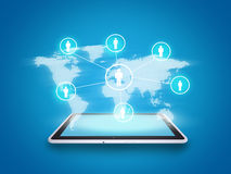 Tablet with world map and people symbols Royalty Free Stock Photography