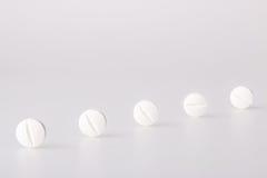 Tableta blanca de la droga Foto de archivo
