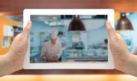 Tableta borrosa cocina del fondo Fotografía de archivo