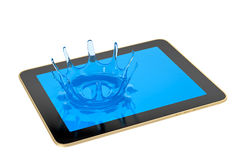 Tableta - chapoteo líquido Fotografía de archivo libre de regalías