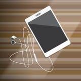 Tableta con el auricular en la mesa de madera Imagenes de archivo