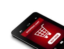 Tableta con el carro de la compra sobre blanco Fotos de archivo libres de regalías