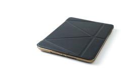 Tableta con el caso de cuero Imagen de archivo