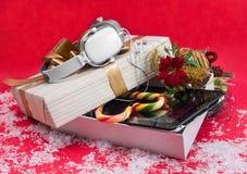 Tableta con el mejor regalo 2015 de la Navidad de los auriculares Fotografía de archivo
