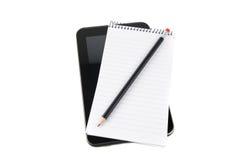 Tableta con la libreta Imágenes de archivo libres de regalías