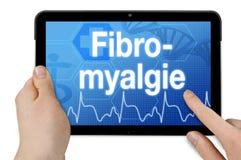 Tableta con la palabra alemana para el fibromyalgia - Fibromyalgie imagen de archivo