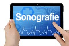 Tableta con la palabra alemana para la sonografía - Sonografie fotos de archivo libres de regalías