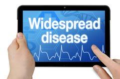 Tableta con la pantalla táctil y la enfermedad extensa foto de archivo libre de regalías