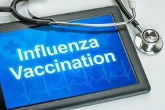 Tableta con la vacunación de la gripe del texto Foto de archivo
