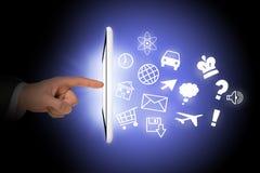 Tableta con los iconos y la mano de los seres humanos Imagen de archivo