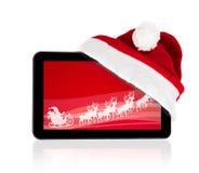 Tableta con Santa Claus en la pantalla roja Imagen de archivo libre de regalías