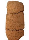 Tableta de arcilla con la escritura cuneiforme Foto de archivo
