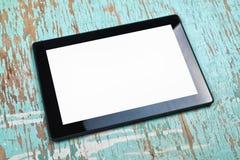 Tableta de Digitaces con la pantalla blanca en blanco Imagen de archivo