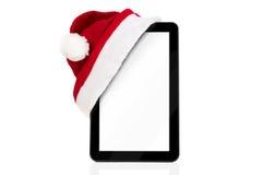 Tableta de la Navidad con el sombrero de Papá Noel Fotos de archivo