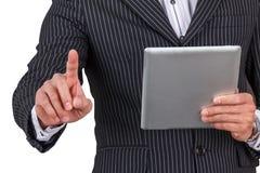 Tableta de la tenencia de Hand del hombre de negocios Imagen de archivo