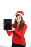 Tableta de la tenencia de la muchacha de Santa Claus Christmas Asian Imagenes de archivo