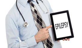 Tableta de la tenencia del doctor - epilepsia Foto de archivo libre de regalías