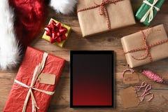 Tableta de los regalos de Navidad Foto de archivo