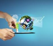 Tableta de tacto en manos Foto de archivo libre de regalías