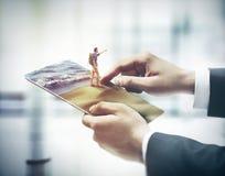 Tableta digital conmovedora del finger, concepto del día de fiesta foto de archivo libre de regalías