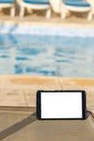 Tableta digital en blanco con el espacio vacío para el texto encendido Imagen de archivo