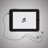 Tableta negra con los auriculares Imagenes de archivo