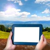 Tableta negra con una pantalla en blanco Fotografía de archivo libre de regalías