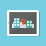 Tableta plana del estilo con la navegación de los gps en ciudad Imagen de archivo libre de regalías