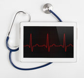 Tableta que muestra el diagrama de ECG Fotos de archivo