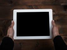 Tableta y manos Fotos de archivo