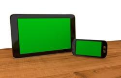Tableta y mobil con las exhibiciones en blanco Fotografía de archivo libre de regalías