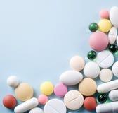 Tabletas con las cápsulas. Fotografía de archivo
